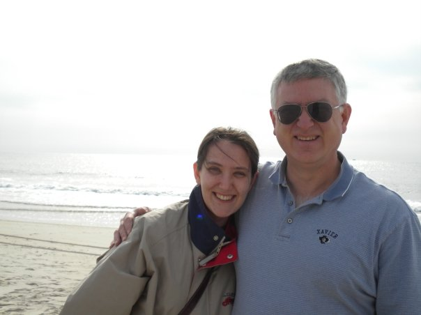 bethany and her dad in front of a beach