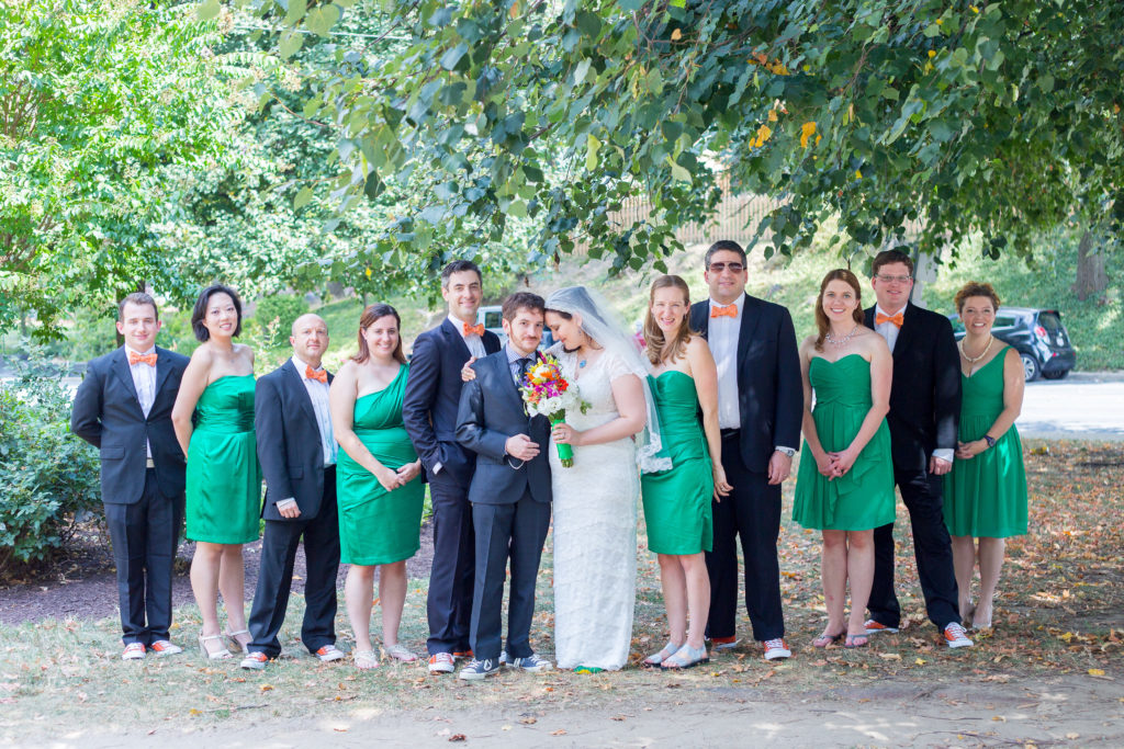 Bethany and Jarrod with their wedding party under some trees